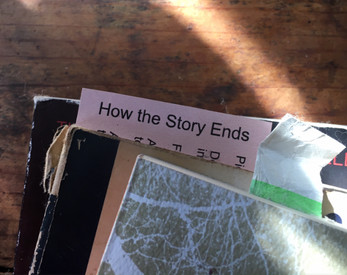 a card used as a bookmark: How the Story Ends